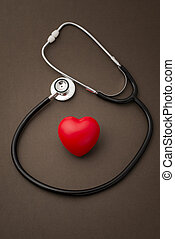 Stehoscope Around a Red Rubber Heart on Brown Background
