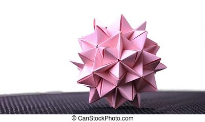 Stellated origami ball on white background. Spiky origami...