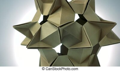 Stellated spiky origami figure. Cosmic ship made from paper....