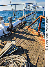 stem deck of a ship, with anchor and rope, walking on the...