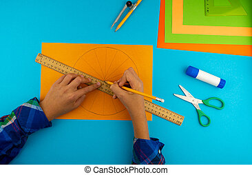 Step 3. Step by step instructions on how to make a pumpkin from colored paper or cardboard. Do it yourself. Glue, a ruler, compasses, scissors. A DIY craft for children. Decoration for the Halloween.