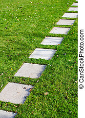 Step by Step - A path through a garden with stone plates