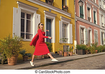 Step by step. Guide to spare time in French capital. Woman total red outfit enjoy walk beautiful street Paris. Parisian carefree relaxed walks on sunny day. Leisure and cultural attractions in Paris