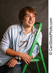Step-ladder - The young man with a green step-ladder