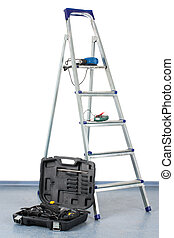 Step-ladder with a tool box - open tool box stands near the...