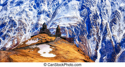 14th century Gergeti Trinity Church (Georgian Orthodox) high in the mountains above Stepantsminda Caucasus