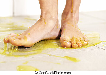 Stepping into slime - Young woman playing with melted Jelly ...