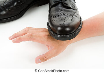 Stepping on a hand - Black shoes and hand, Concept of power,...