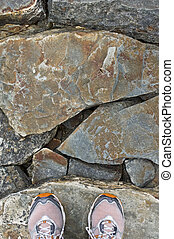 Stepping Stones - Sneakers on rock stones on a footpath
