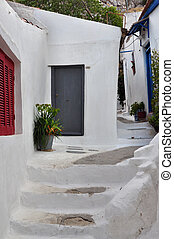 steps and white painted narrow street - Steps, white painted...