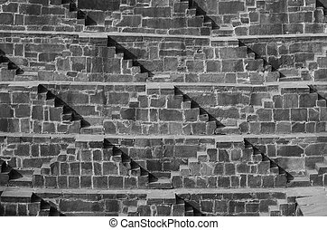 Steps at Chand Baori Stepwell in the village of Abhaneri, Rajasthan, India. (Black and White)