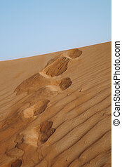 Steps in the desert. Beautiful sand background