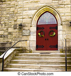 Steps to the Red Doors of a Church - Stone steps lead to the...