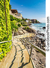 steps to the rocky shore from the old town - ancient...