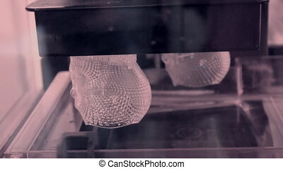 Stereolithography DPL, SLA 3d printer creating shape by UV...