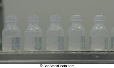 Sterilized clogged plastic bottles with medicine on the...