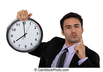 Stern businessman with a clock