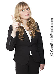 Stern beautiful young businesswoman with long blond hair delivering a reprimand raising her finger in the air to emphasise a point, isolated on white