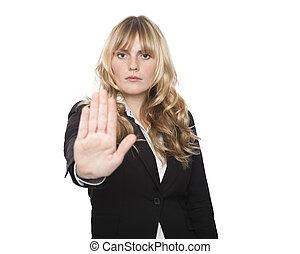 Stern businesswoman making a stop gesture - Stern attractive...