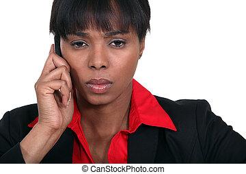 Stern businesswoman making call