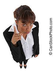 Stern businesswoman pointing finger
