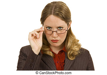 Stern businesswoman on white looking over her glasses