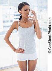 Stern model using her asthma atomizer after exercising