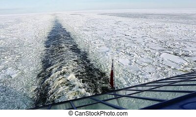Stern of a ferry - Ship heading through a frozen Baltic sea