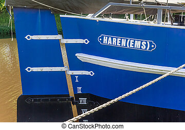 Stern of a ship with the name of the city in Haren, Germany