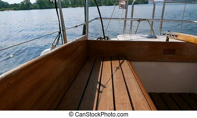 Stern of small sailing yacht at summer day.