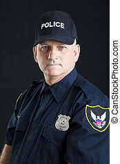 Stern Policeman Portrait - Portrait of a serious police...