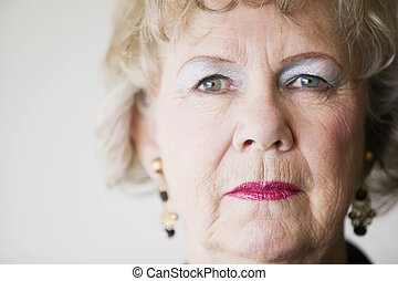 Close-up of a senior woman with a blank look.