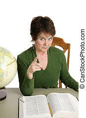 Stern Teacher - A stern looking teacher or librarian shaking...