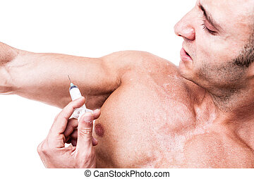 Steroids - a muscular man giving himself a steroid injection...