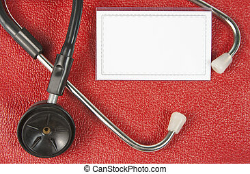 Stethoscope and blank business card