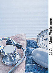 stethoscope and blood pressure monitor on blue background medica