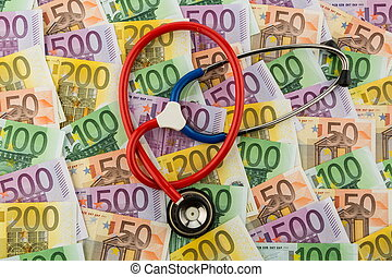 stethoscope and euro banknotes. symbol photo for costs in...