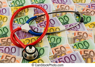 stethoscope and euro bills. symbolic photo for healthcare...