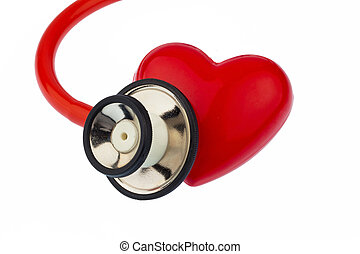 stethoscope and heart - a stethoscope and a heart on a white...