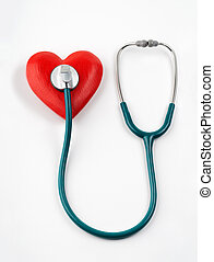 Stethoscope and heart - Stethoscope is monitoring a wooden...