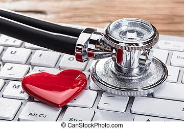 Stethoscope And Heart Shape On Keyboard