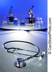 Stethoscope and Microscopes In Medical Research Laboratory -...