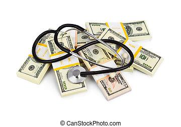 Stethoscope and money isolated on white background