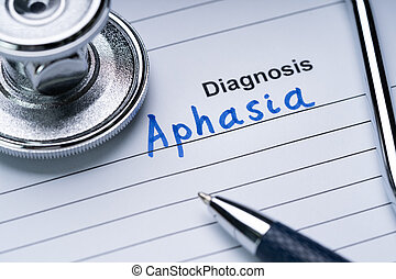 Stethoscope And Pen Over Form With Diagnosis Aphasia