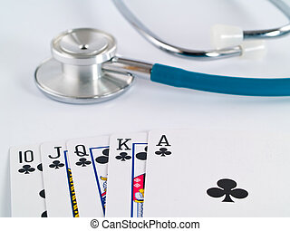 Stethoscope and Playing Cards as a Gambling with your Health Concept