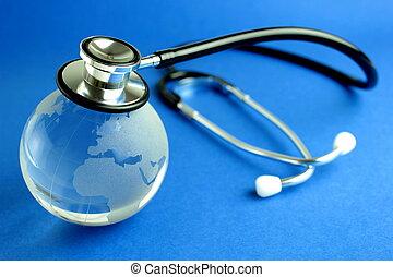 Stethoscope and world, close up image