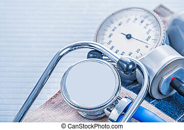 stethoscope blood pressure monitor on blue background medical