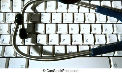 Stethoscope falling onto computer keyboard and then...