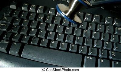 Stethoscope falling onto keyboard