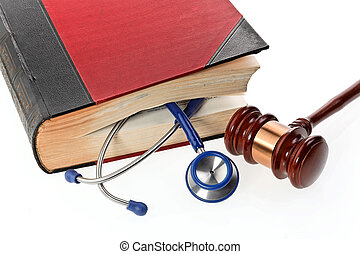A blue stethoscope liegtn in a medical book